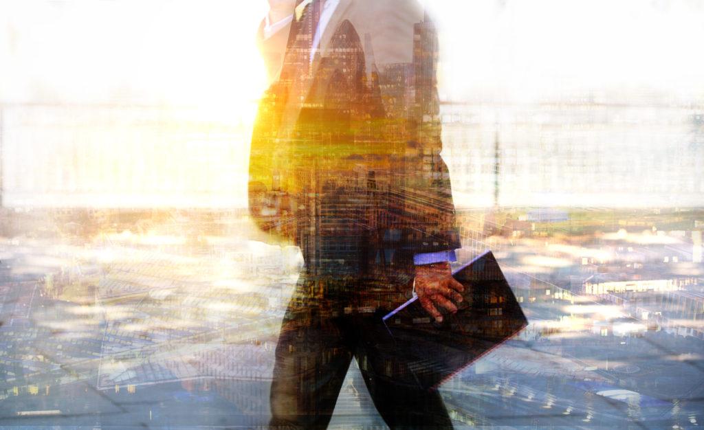 Businessman,Walking,Against,Of,Sunrise,Light.,Business,Life,Concept